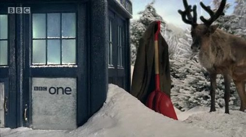 doctor who christmas ident - a reindeer by the tardis  in the snow